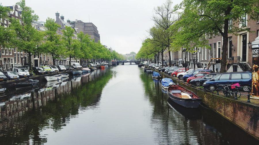 Water Canal Reflection Day Outdoors Building Exterior Moored No People Nautical Vessel Architecture Tree Travel Destinations Sky Nature Amsterdam Taking Pictures Amsterdamcity Traveling Travel Travel Photography PhonePhotography Phonephotograpy Enjoying Life Netherlands Olanda