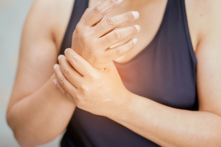 Midsection of woman with wrist pain
