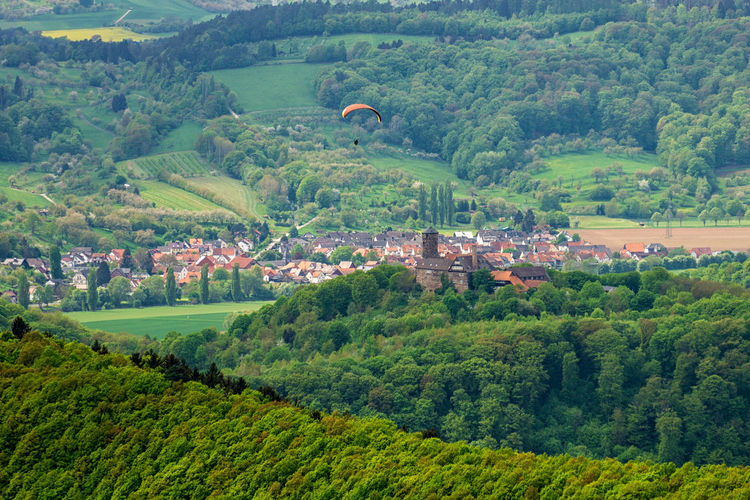 Paraglider flying over Burg Ludwigstein Burg Ludwigstein Castle Deutschland Paragliding Thuringia Architecture Building Built Structure Forest Germany Green Color High Angle View Land Landscape Nature Outdoors Paraglider Scenics - Nature