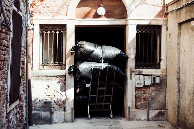 Garbage Bags On Cart In Doorway Of House
