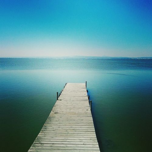Water Sea Pier Horizon Over Water The Way Forward Tranquility Tranquil Scene Scenics Clear Sky Wood - Material Blue Empty Beauty In Nature Idyllic Copy Space Nature Jetty Tourism Ocean Calm