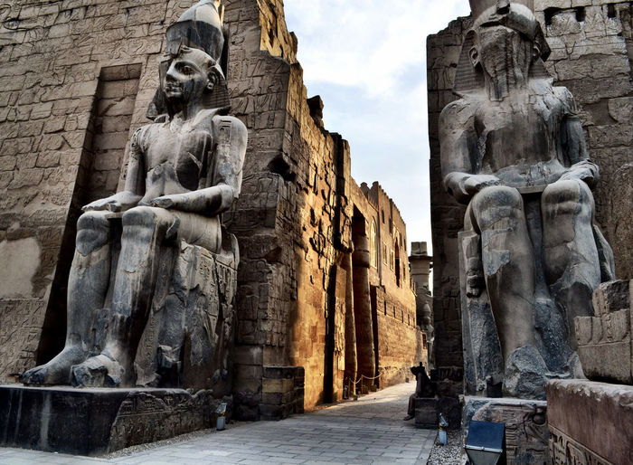 Low angle view of pharaoh statues at luxor temple