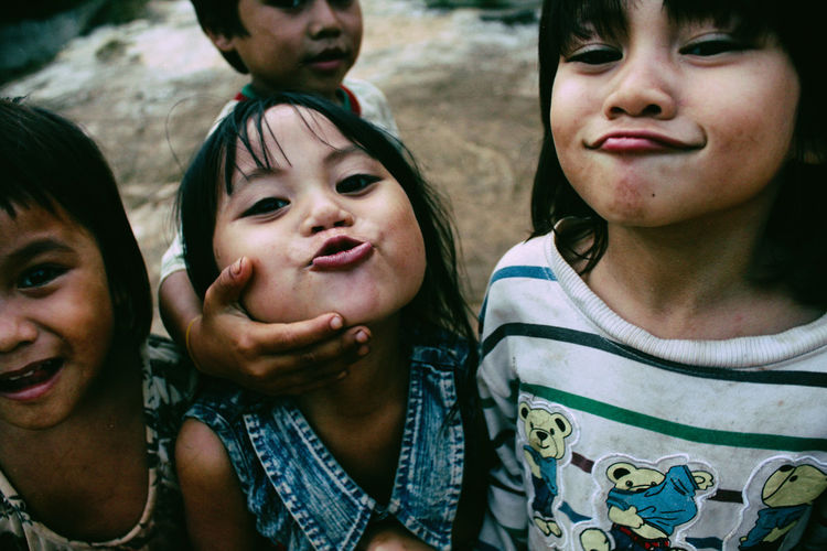 Happiness of poor children on highlands. Children Happiness Happy Life Child Childhood Close-up Day Friendship Happiness Lifestyles Looking At Camera Outdoors People Poor Children Portrait Portrait Of Children Real People Smiling Togetherness