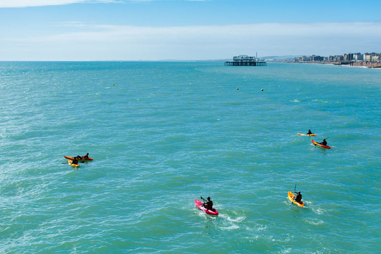Water Leisure Activity Lifestyles Waterfront Turquoise Colored People Watersports Canoing Rowing Rowing Boat Sea Real People Beauty In Nature Horizon Over Water Day Group Of People Nature Sport Aquatic Sport Men Blue Outdoors Brighton Brighton Beach Sports Human Connection