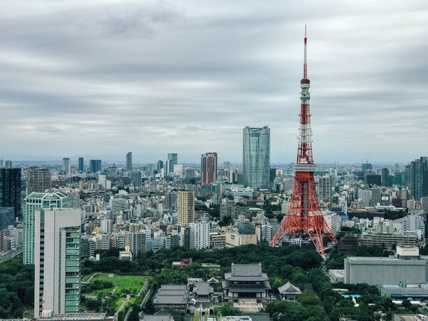 Architecture Tower Built Structure Tall - High City Building Exterior Skyscraper Sky Cityscape Tall Cloud Modern Office Building Travel Destinations Spire  Cloud - Sky Urban Skyline Financial District  Urban Scene Outdoors Tokyo,Japan Tokyo Tokyo Tower