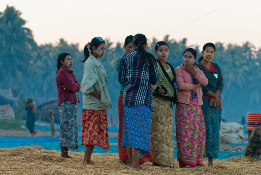 Baby it's cold outside. Women of the fishing crews waiting for their husbands until they are released from the boats Fishing Village Rakhine State Adult Casual Clothing Clear Sky Day Focus On Foreground Front View Full Length Lifestyles Medium Group Of People Myanmar Nature Outdoors People Portrait Real People Sky Standing Togetherness Women Young Adult Young Men Young Women