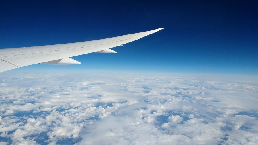 Aerial View Of Airplane Wing Against Sky