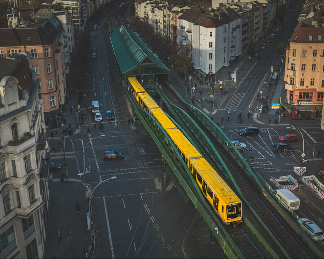 High angle view of train on railway bridge amidst building in city