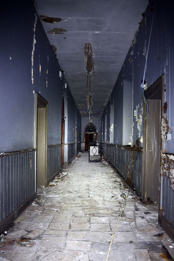 Corridor Decay And Dereliction Disused Building Falling Apart Indoors  Uninhabitable