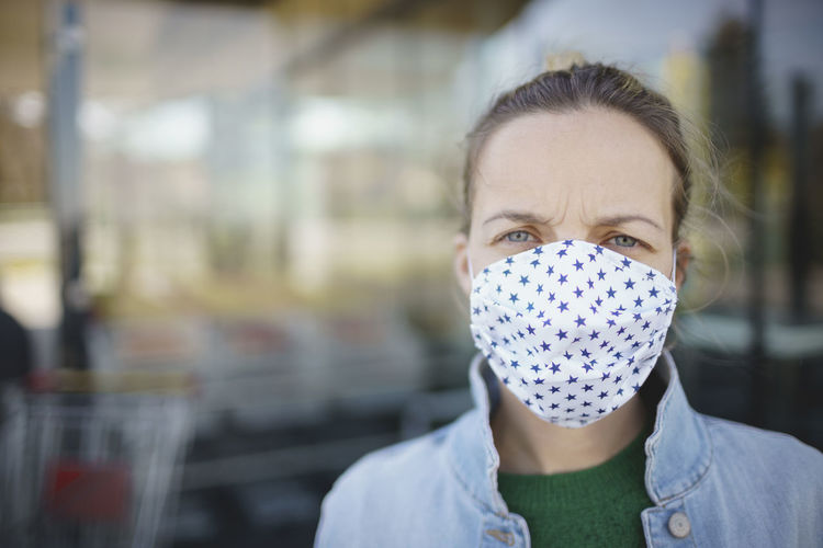Close-up portrait of woman wearing mask outdoors