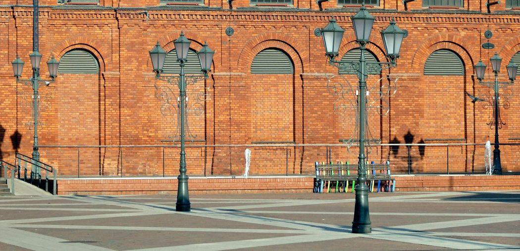 Street lights against building