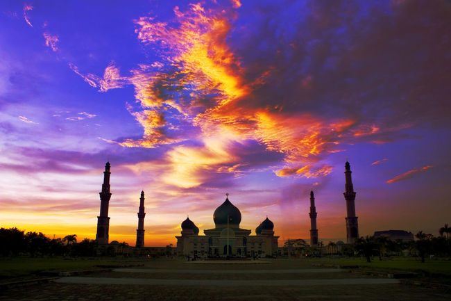INDONESIA Architecture Belief Building Building Exterior Built Structure Cloud - Sky Dome Mosque Nature No People Orange Color Place Of Worship Religion Sky Spirituality Sunset Tourism Travel Travel Destinations