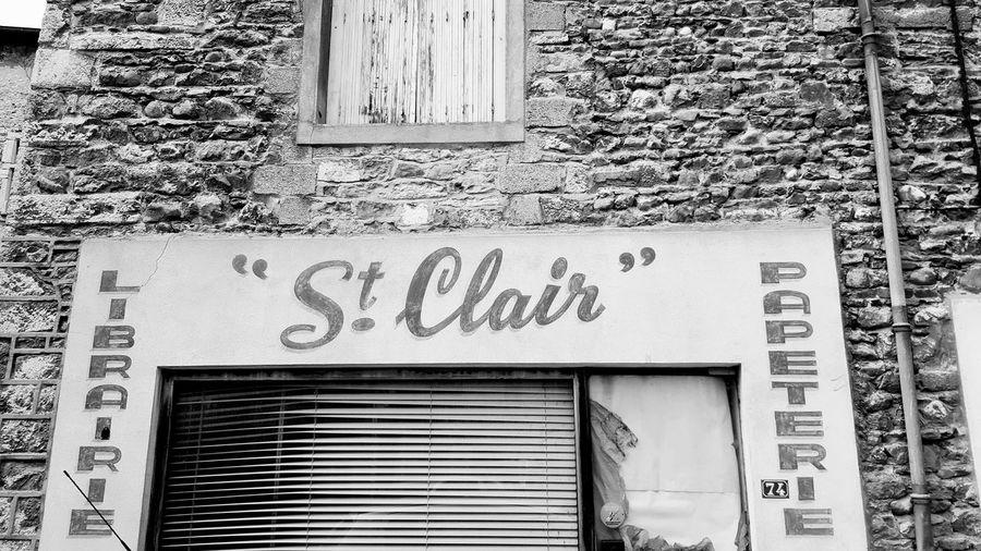 Text Western Script Architecture Built Structure Communication Building Exterior Door Day No People Outdoors Close-up Vintage Shop Shop Sign