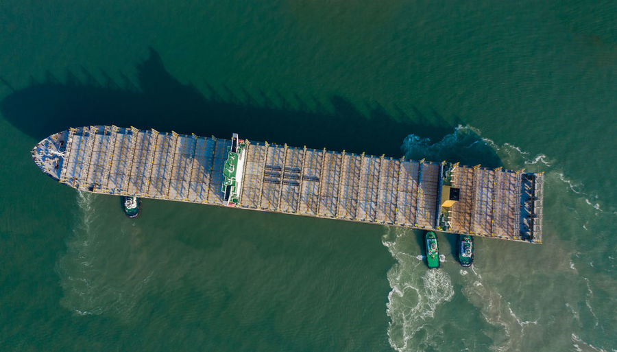 Aerial view of commercial dock in sea