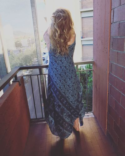One Person Rear View Real People Window Standing Indoors  Day Women Blond Hair Young Adult People Adult Architecture Lifestyles Full Length women looking at view