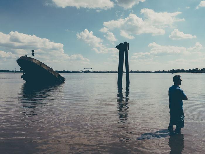 Man Standing In Elbe River Against Sky