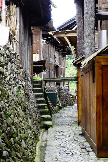 village street China,Guizhou Wall Door Architecture Building Exterior Built Structure Narrow Walkway Cobblestone Entryway Pathway Traditional Building