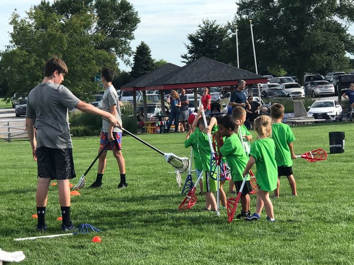 LACROSSE KIDS Lacrosse Group Of People Real People Plant Grass Sport Nature Summer Sports Lifestyles Crowd Leisure Activity Green Color Outdoors Field