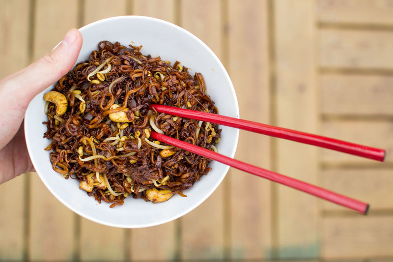 Bowl Brown Cashew Chopsticks Close-up Cropped Food Freshness Fried Lifestyles Meal Noodles Nuts Part Of Ready-to-eat Red Serving Size Soy