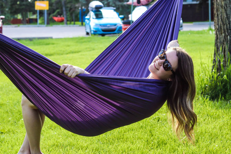 Sunshine and happiness coincide in my world 🌏 Sunshine Laughter Happiness one person Lying Down Grass Smiling Only Women Leisure Activity Happiness Relaxation Outdoors Young Adult Summer 67mm Filter EyeEmNewHere Hobby Canada 150 Transportation Canon80d Edmonton Alberta Outside Park Hammock Hammock Urban