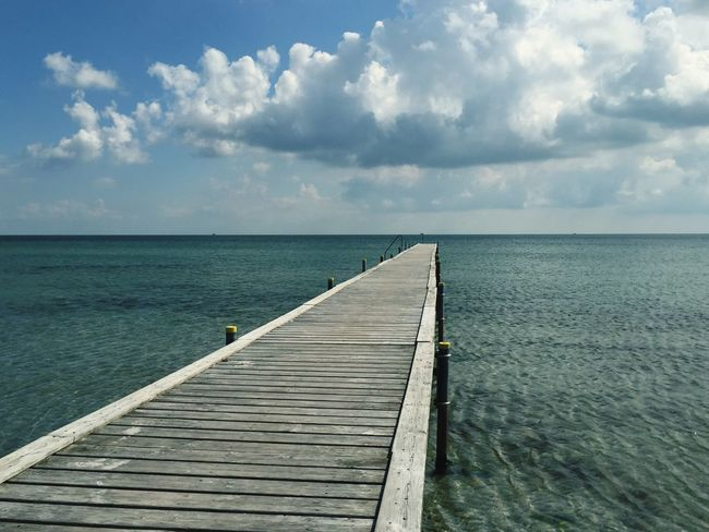 Sea Horizon Over Water Water The Way Forward Scenics Tranquility Tranquil Scene Beach Pier Sky Beauty In Nature Idyllic Wooden Nature Boardwalk Tourism Cloud - Sky Day Seascape Vacations
