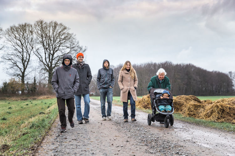 Family walking on road