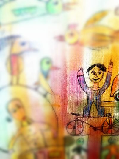 Selective Focus Creativity Multi Colored Painted Canvas Man With Bicycle For Kids Fantasy Detail
