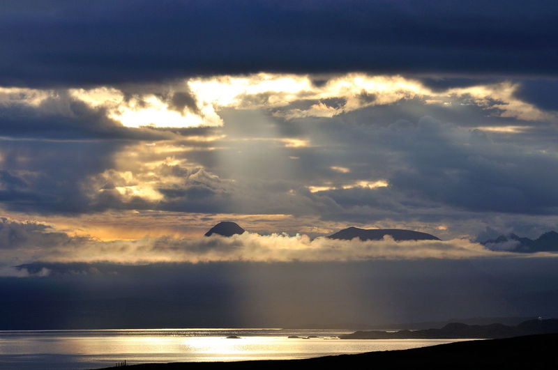 The mountains of the west coast of Scotland at dawn - seen from Culnacnoc on the Isle of Skye Beauty In Nature Cloud - Sky Cloudscape Dawn Dramatic Sky Highlands Morning Mountain Range Mountains Nature Non-urban Scene Remote Scenics Scotland Sea Sky Skye Sun Sunbeam Sunrise Tranquil Scene Water