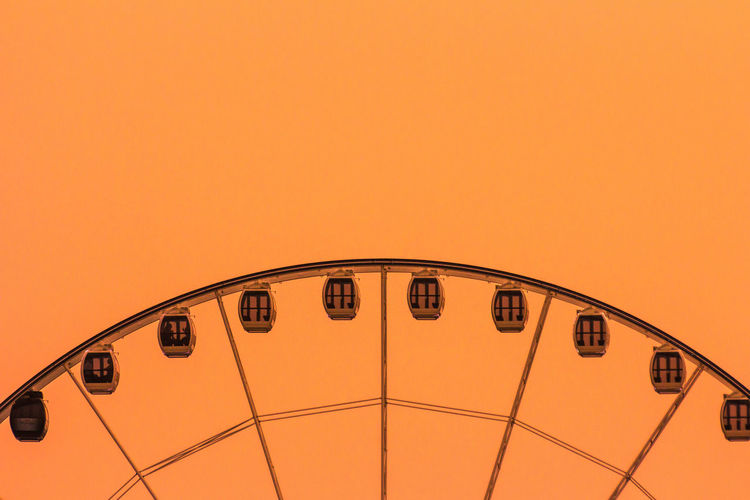 Close up of electric lamp against sky