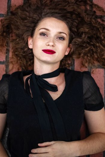 Portrait Hairstyle One Person Women Adult Curly Hair Beauty Looking At Camera Young Adult Beautiful Woman Front View Redhead Brown Hair Hair Waist Up Headshot Indoors  Black Color Fashion Contemplation