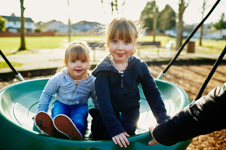 Childhood Child Two People Leisure Activity Togetherness Girls Real People Emotion Happiness Smiling Females Casual Clothing Day Men Males  Innocence Playground Women Sister Hair Positive Emotion Outdoors Outdoor Play Equipment