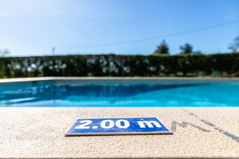 Close-up of text on swimming pool