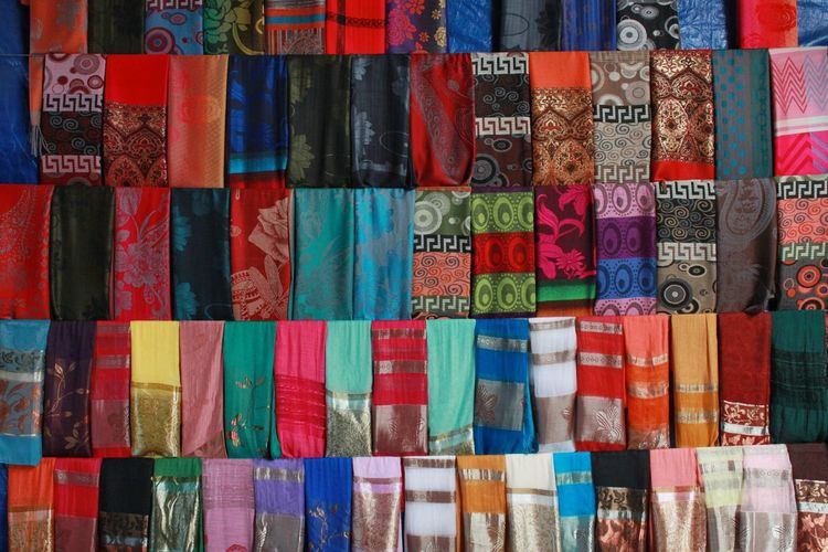 A stack of silk Multi Colored Large Group Of Objects Full Frame Stack Backgrounds Collection Cultures Market Street Market No People Fabric Fabric Texture Fabric Detail Textured  Detail Art đàlạt Vietnam Dalat Colorful Colors Variation Choice Abundance In A Row