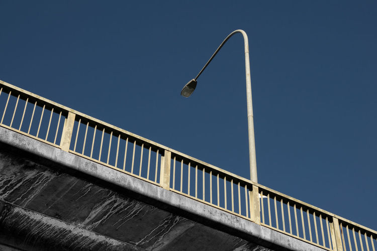 Lantern Lines Path Above Architecture Below Blue Bridge Bridge - Man Made Structure Building Exterior Built Structure Cement City Clear Sky Color And B&w Colour And Black And White Day Diffrentperspective Low Angle View No People Outdoors Railing Sky Street Light Urban The Architect - 2018 EyeEm Awards