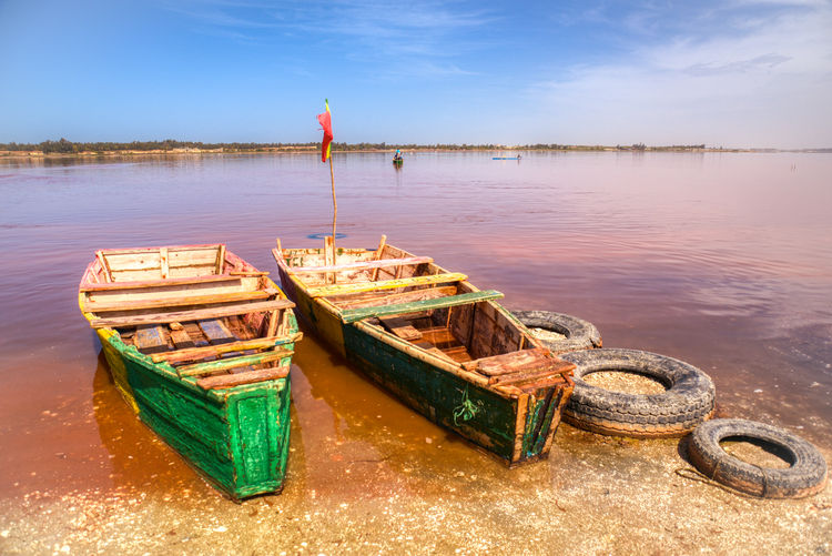 Boats on the lac Rose Water Nautical Vessel Transportation Mode Of Transportation Sky Lake Nature No People Reflection Moored Day Wood - Material Tranquility Scenics - Nature Outdoors Absence Flag Tranquil Scene Rowboat Fishing Boat