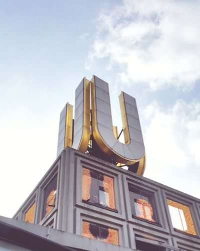 Low Angle View Of Letter U On Building Against Sky