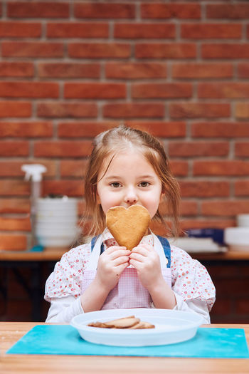 Portrait of a girl eating food