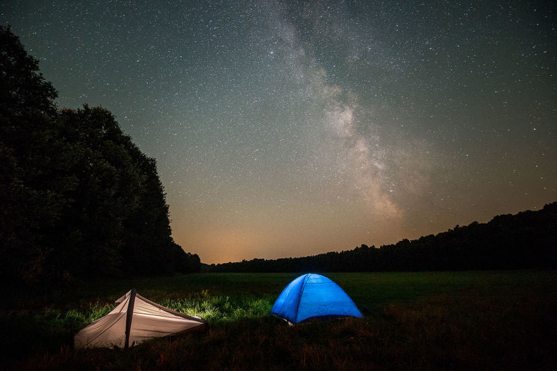 Tents On Field Against Sky At Night
