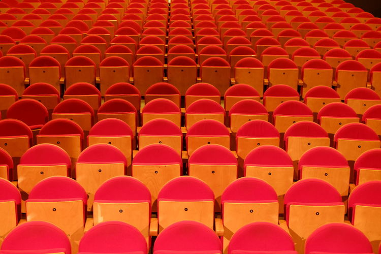 Close-up of red seats in stadium