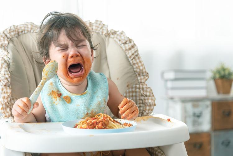 Cute girl having food in plate