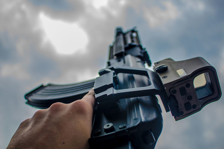 // Cloudy K 🔫 Gun Weapon Handgun Shooting A Weapon Cloud - Sky Human Body Part Human Hand One Person Holding Pistol Adult Outdoors Close-up