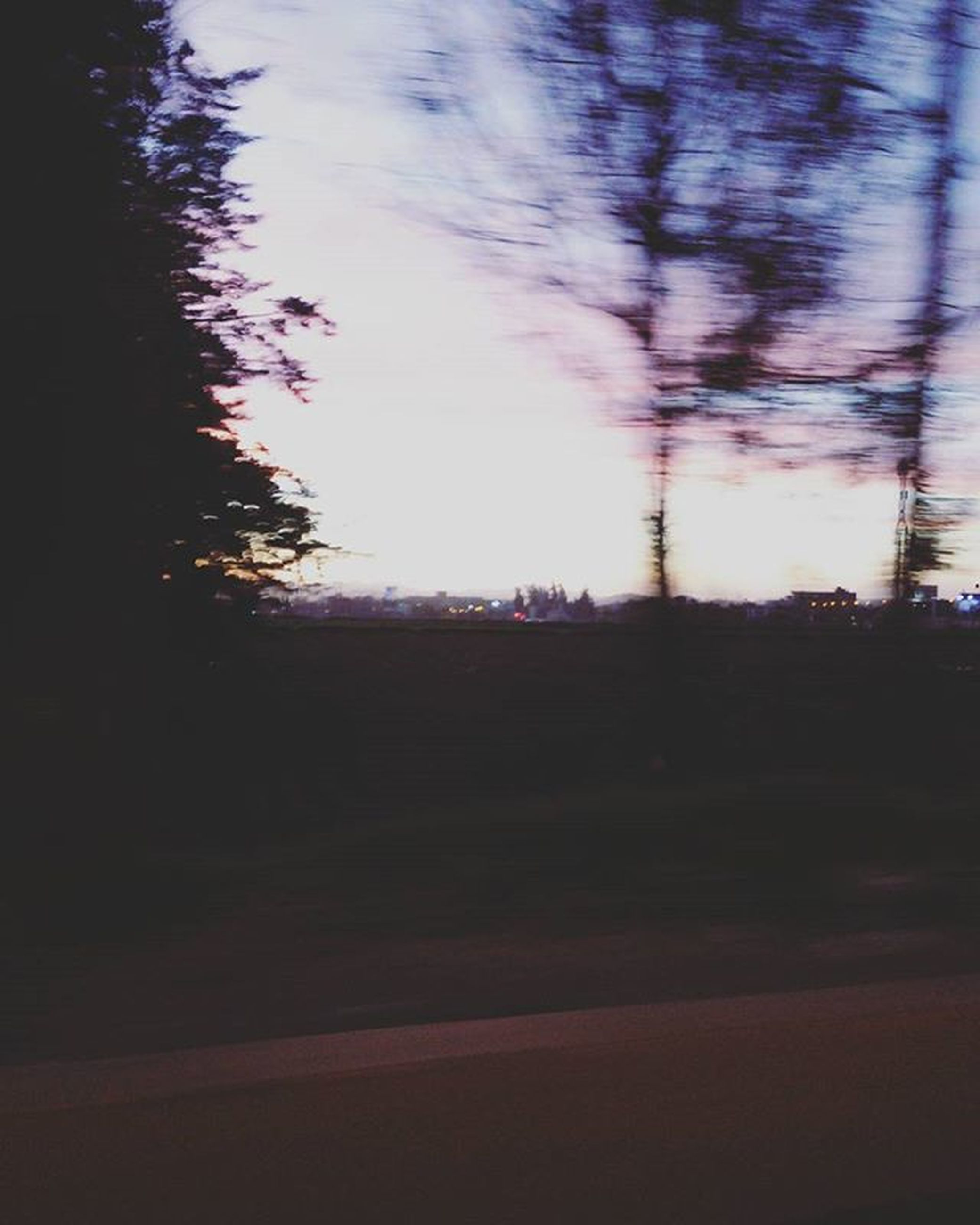 tree, silhouette, road, sky, tranquility, dark, tranquil scene, bare tree, transportation, dusk, nature, street, sunset, the way forward, no people, scenics, outdoors, night, empty, beauty in nature