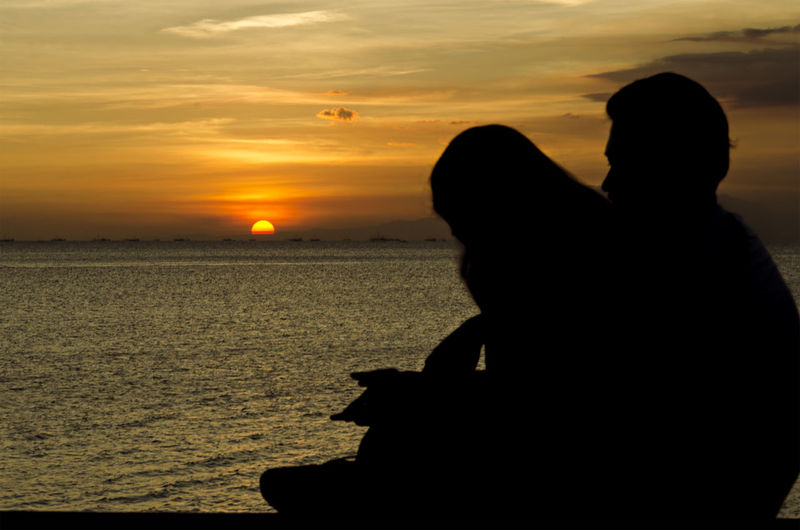 Sunset Silhouette Two People Beauty In Nature Leisure Activity Scenics Togetherness Outdoors Lifestyles Nature People Arts Culture And Entertainment Tranquility Atmospheric Mood TakeoverContrast