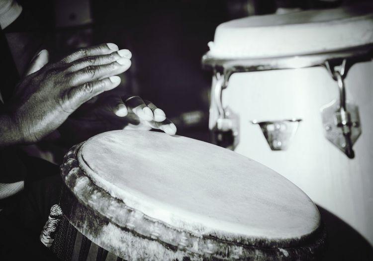 Cropped image of man playing drums