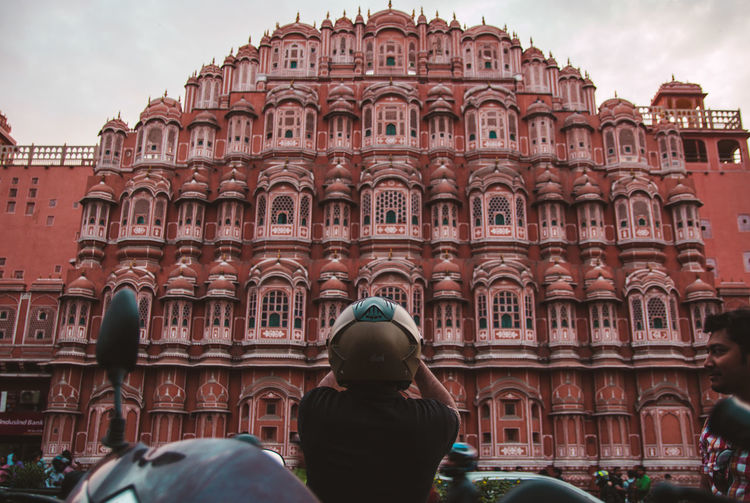 The icon of Jaipur - the pink city ... Travel Exploring Jaipur Rajasthan Hawamahal Streetphotography Photographer Biker Helmet Point Of View Young Adult Streetphotography Travelling Rear View Architecture City Statue History Ancient Architecture Historic Visiting Arch Civilization The Past Archway Historic Building Colonnade Gothic Style Triumphal Arch The Traveler - 2019 EyeEm Awards The Street Photographer - 2019 EyeEm Awards The Architect - 2019 EyeEm Awards