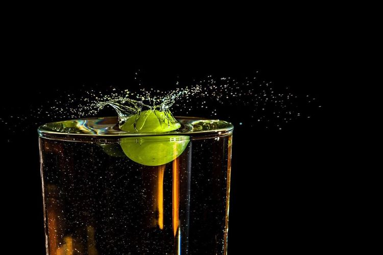 Studio Shot Black Background Drinking Glass Drink Splashing Refreshment Motion Food And Drink No People Freshness Cold Temperature Close-up Indoors  Alcohol