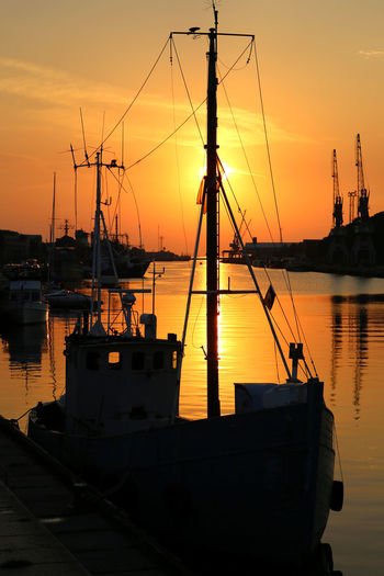 Flaming Sunset Harbor Liepaja Liepaja Old Port Liepajas Mencini Mode Of Transport Nautical Vessel Old Port Reisen In Lettland Sailboat Sunset Sunset_collection Travelling The Baltic States 43 Golden Moments On The Way