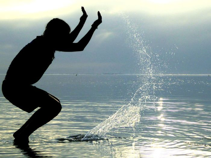 Water Silhouette Vitality One Person Motion Outdoors Only Women Sportsman Day Nature Sky Sea Sprinkle Sprinkles