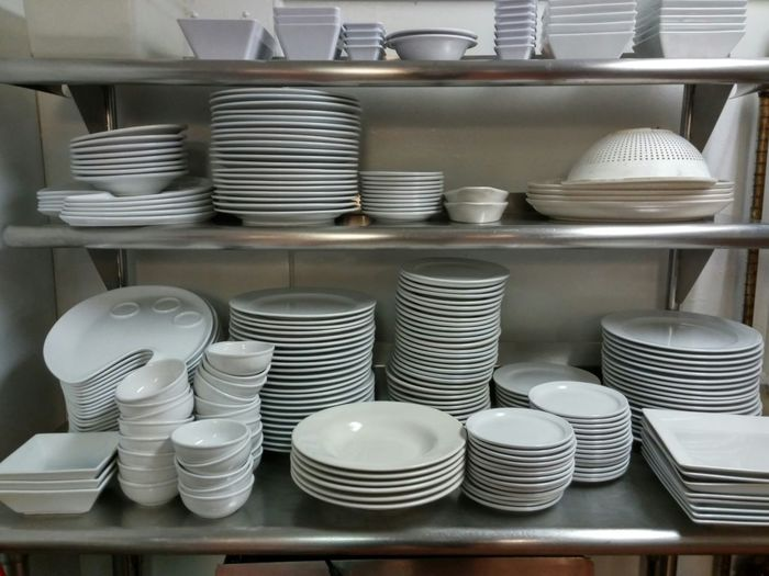 View of plates on shelf