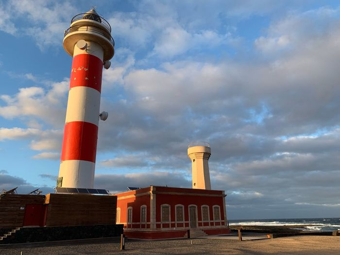 Canary Islands Fuerteventura Architecture Cloud - Sky Sky Built Structure Lighthouse Tower Building Exterior Guidance Nature Sea Tall - High Water Security Protection No People Safety Beach Outdoors Day
